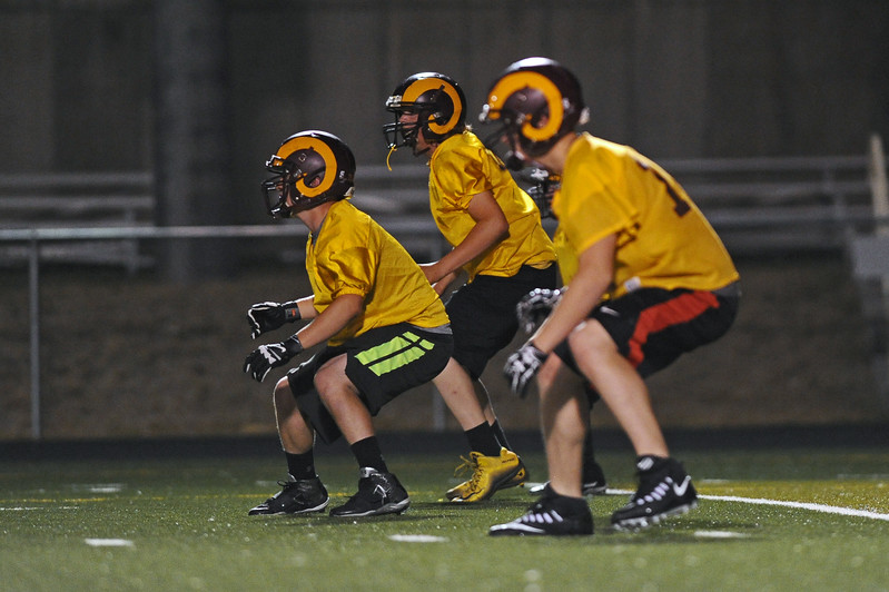 Big Horn linemen break out of their stances during midnight practice on Wednesday, Aug. 9 at Big Horn High School. Mike Pruden | The Sheridan Press
