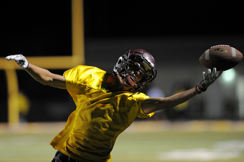Kade Van Dyken stretches for a long pass during midnight practice on Wednesday, Aug. 9 at Big Horn High School. Mike Pruden | The Sheridan Press