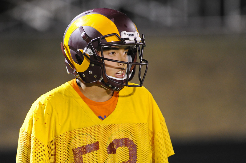 Wyatt Emond takes a break before the start of a drill during midnight practice on Wednesday, Aug. 9 at Big Horn High School. Mike Pruden | The Sheridan Press