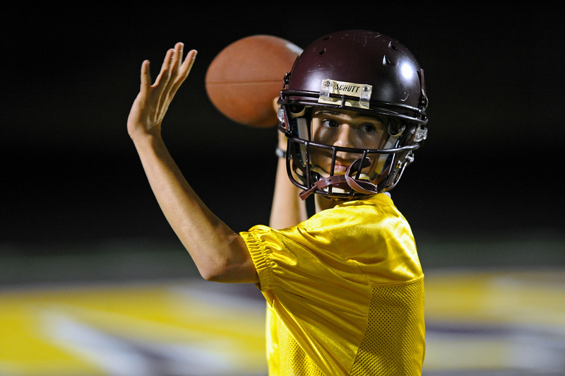 Quarterback Robert Morton warms up his arm during midnight practice on Wednesday, Aug. 9 at Big Horn High School. Mike Pruden | The Sheridan Press