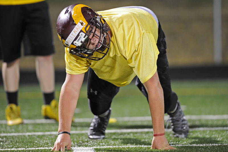Lineman Seth Mullinax runs through a conditioning drill during midnight practice on Wednesday, Aug. 9 at Big Horn High School. Mike Pruden | The Sheridan Press