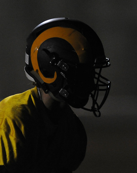 A member of the Big Horn football team is silhouetted by the moonlight during midnight practice on Wednesday, Aug. 9 at Big Horn High School. Mike Pruden | The Sheridan Press