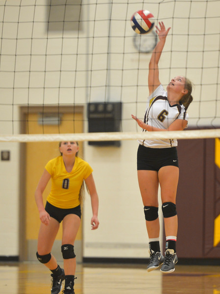 Justin Sheely | The Sheridan Press<br /> Big Horn's Kristen Carlson Tazmyn Olson hits the ball as Emma Enloe (0) looks on in the game against the Tongue River High School Lady Eagles Thursday at Big Horn High School. The Lady Rams topped the Lady Eagles in all three sets: 25-22, 25-18, 25-22.