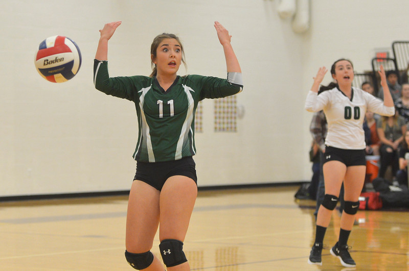 Justin Sheely | The Sheridan Press<br /> Tongue River High School's Zaveah Kobza, left, and Jenna Keller indicate the ball is out in the first set of the game against the Lady Rams Thursday at Big Horn High School. The Lady Rams topped the Lady Eagles in all three sets: 25-22, 25-18, 25-22.