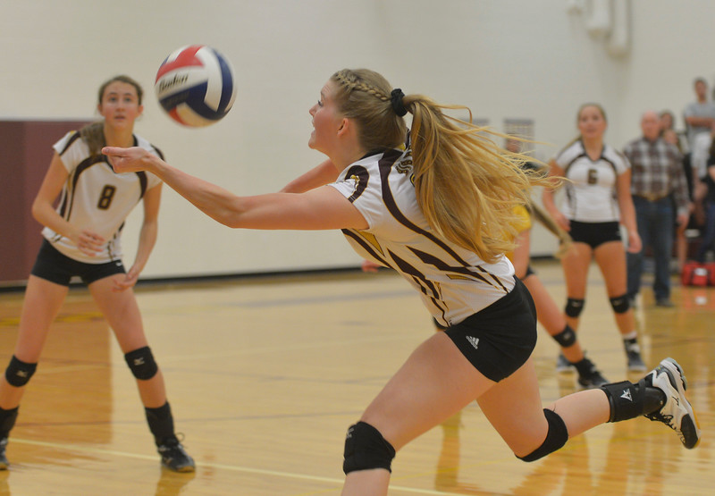 Justin Sheely | The Sheridan Press<br /> Big Horn's Kristen Carlson chases the ball during the game against the Tongue River High School Lady Eagles Thursday at Big Horn High School. The Lady Rams topped the Lady Eagles in all three sets: 25-22, 25-18, 25-22.