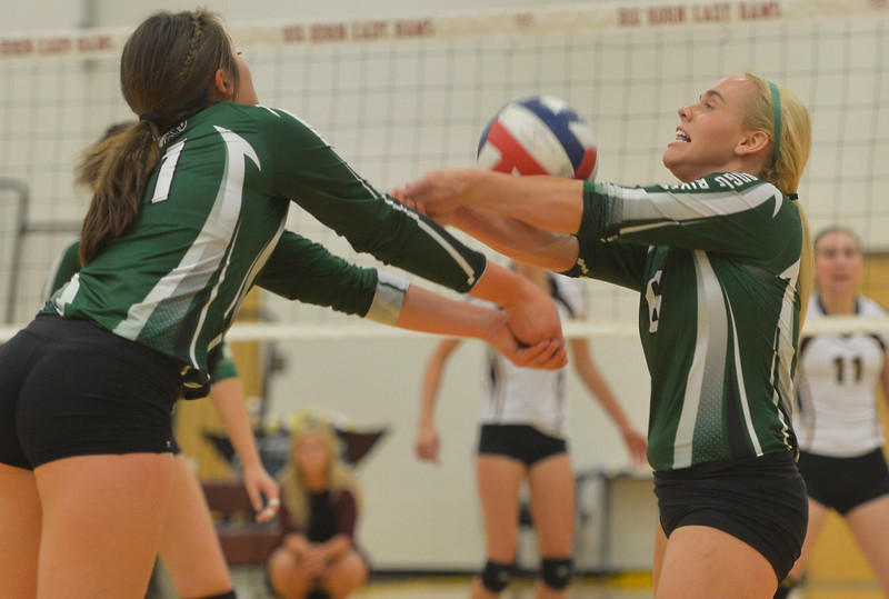 Justin Sheely | The Sheridan Press<br /> Tongue River High School's Brittany Fillingham, right, gets the ball over Zaveah Kobza during the game against the Lady Rams Thursday at Big Horn High School. The Lady Rams topped the Lady Eagles in all three sets: 25-22, 25-18, 25-22.
