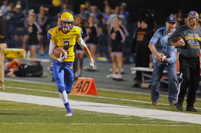 Aaron Sessions races up the sideline for a 70-yard touchdown against Natrona on Friday, Sept. 8 at Homer Scott Field. Mike Pruden | The Sheridan Press