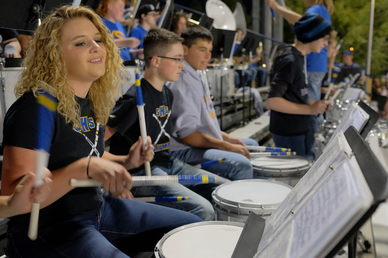 Justin Sheely | The Sheridan Press<br /> Sheridan pep band member Logan Livingston plays the drums during the game against the Mustangs Friday night at Sheridan High School.