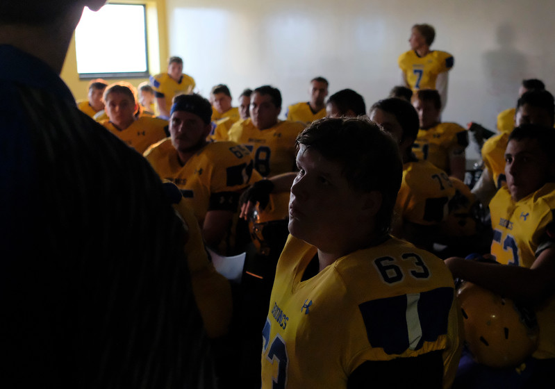 Justin Sheely | The Sheridan Press<br /> Hunter Murphy looks on as the Sheridan Broncs listen to the coaching staff in the War Room prior to the game against the Mustangs Friday night at Sheridan High School.