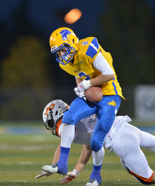 Justin Sheely | The Sheridan Press<br /> Sheridan's Aaron Sessions manages to catch the ball during the game against the Mustangs Friday night at Sheridan High School. The Broncs held on to win 37-34 in overtime.