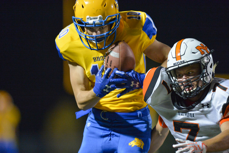 Justin Sheely | The Sheridan Press<br /> Sheridan's wide receiver Blake Vigil catches the ball as Natrona's Tehl Campbell closes in during the game Friday night at Sheridan High School. The Broncs held on to win 37-34 in overtime.