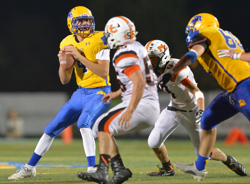 Justin Sheely | The Sheridan Press<br /> Sheridan's quarterback Aaron Woodward looks for an opening during the game against the Mustangs Friday night at Sheridan High School. The Broncs held on to win 37-34 in overtime.