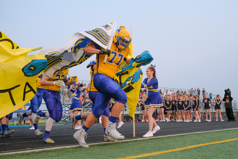 Justin Sheely | The Sheridan Press<br /> Sheridan's Blayne Blaker leads the Broncs onto Homer Scott Field during the game against the Mustangs Friday night at Sheridan High School.