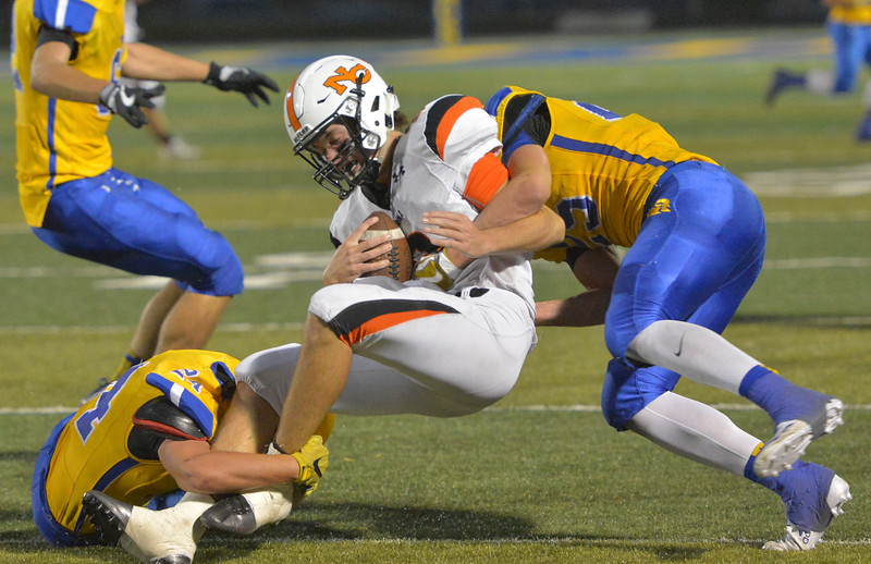Natrona's quarterback is sacked by Sheridan's Kyle Custis, left, and Parker Christensen during the game against the Broncs Friday night at Sheridan High School. Sheridan won in overtime 37-34. Justin Sheely | The Sheridan Press