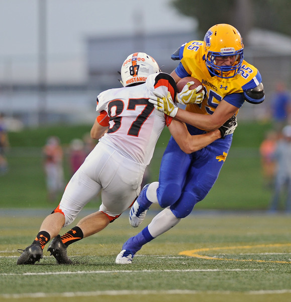 Parker Christensen, right, sheds a Natrona tackler on Friday, Sept. 8 at Homer Scott Field. Mike Pruden | The Sheridan Press