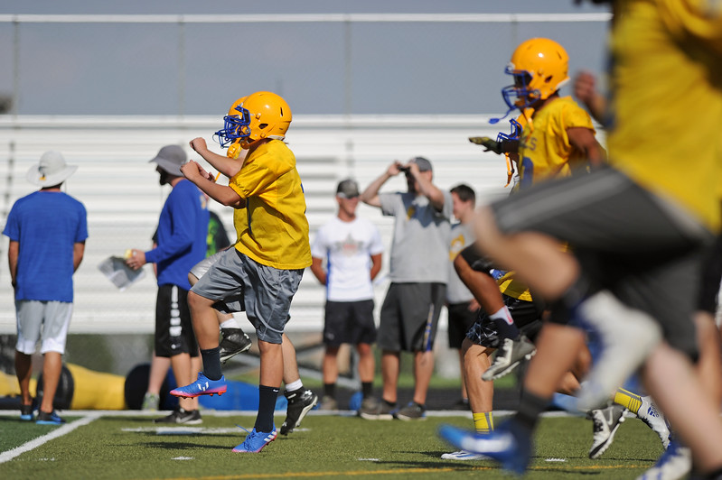 The Sheridan High School football team warms up before practice on Monday, Aug. 7 at Homer Scott Field. Mike Pruden | The Sheridan Press
