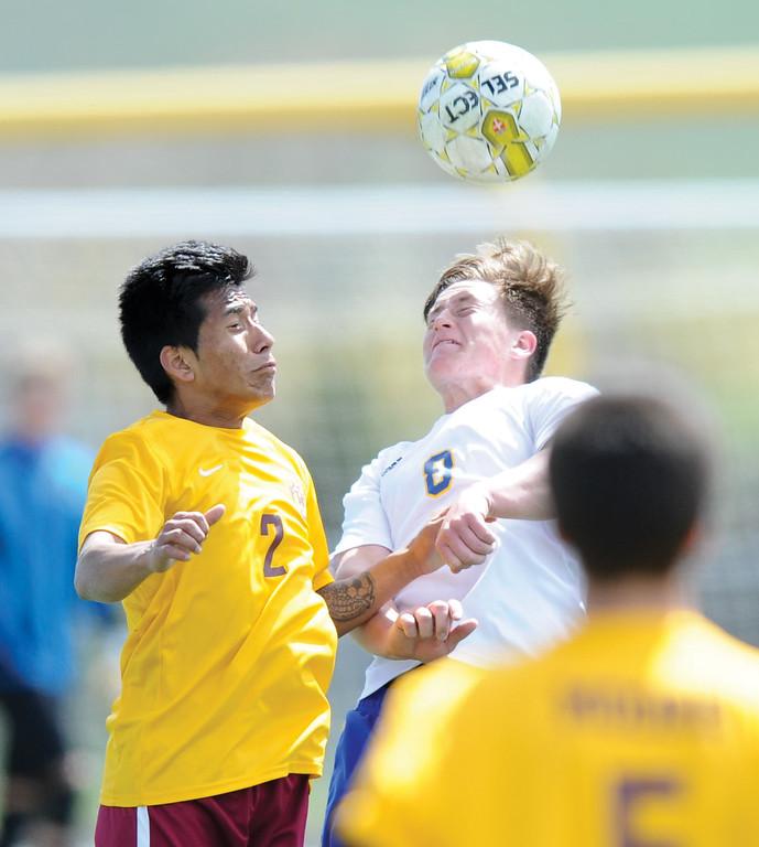 Mike Dunn | The Sheridan Press<br /> Gregg Sampson, right, heads a ball Saturday at Big Horn High School. Sheridan beat Laramie 2-0.