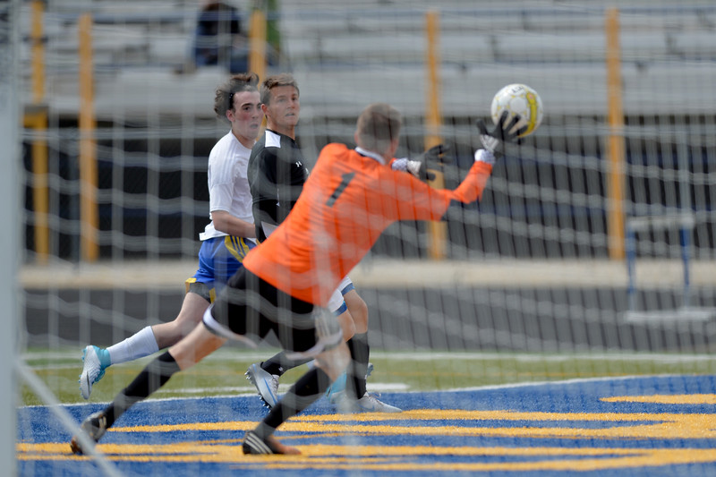 Justin Sheely | The Sheridan Press<br /> Sheridan's Noah Iberlin looks on as the Thunderbirds' goalkeeper deflects a shot during the boys game against Cheyenne East Saturday at Homer Scott Field at Sheridan High School. The Broncs tied with the Thunderbirds after double overtime 1-1.