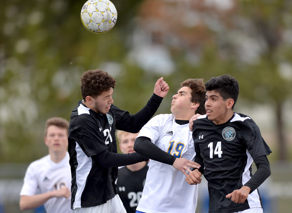 Justin Sheely | The Sheridan Press<br /> Sheridan's Alejandro Artacho, middle, and East's Chayce Willett, left, and Frenando Lechuga go for a header during the boys game against Cheyenne East Saturday at Homer Scott Field at Sheridan High School. The Broncs tied with the Thunderbirds after double overtime 1-1.