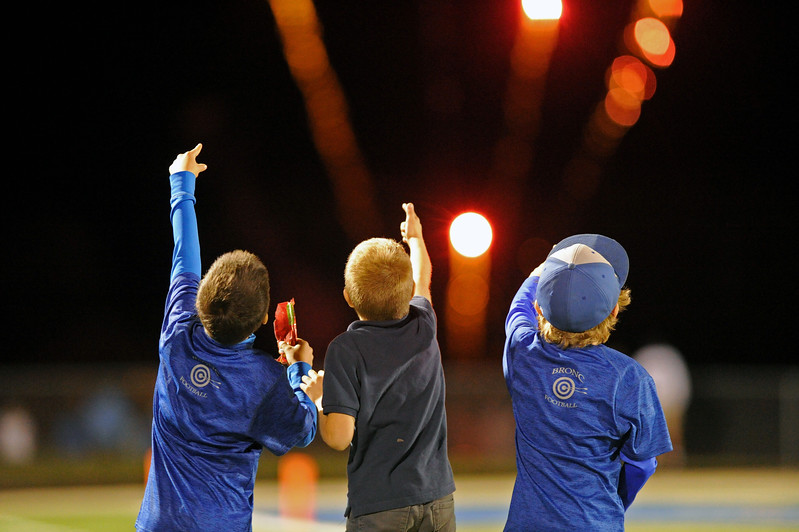 A trio of young Broncs football fans admire the halftime fireworks show on Friday, Sept. 29 at Homer Scott Field. Sheridan utilized three special teams touchdowns in a 52-7 rout of Cheyenne South during homecoming week. Mike Pruden | The Sheridan Press
