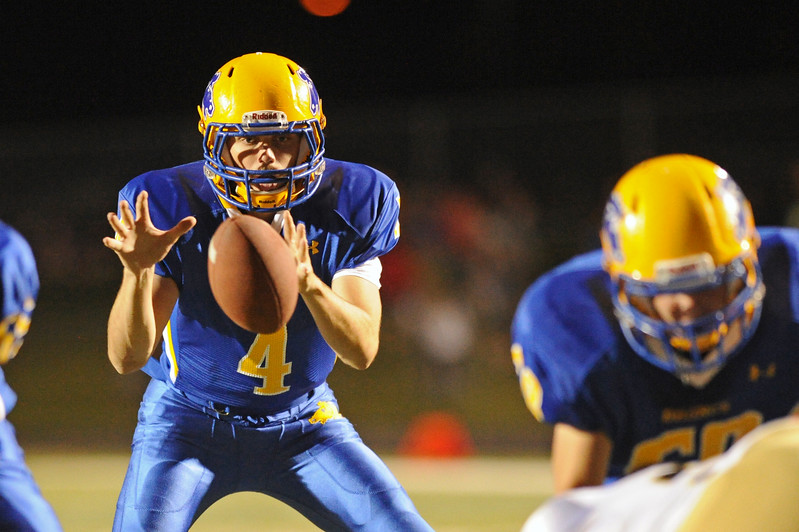 Quarterback Aaron Woodward hauls in a snap on Friday, Sept. 29 at Homer Scott Field. Mike Pruden | The Sheridan Press