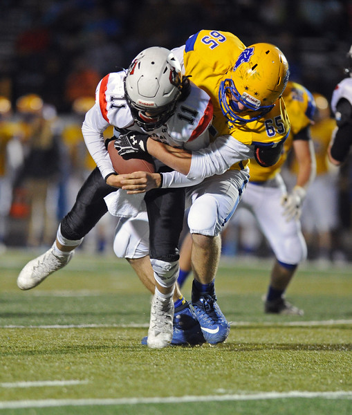 Sheridan's Will Jorgenson, right, sacks Cheyenne Central's Dawson Macleary on Friday, Oct. 27 at Homer Scott Field. Mike Pruden   The Sheridan Press