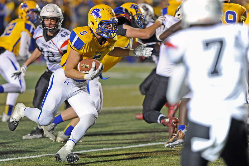 Running back Garrett Coon (5) rushes downfield against Cheyenne Central on Friday, Oct. 27 at Homer Scott Field. Mike Pruden   The Sheridan Press