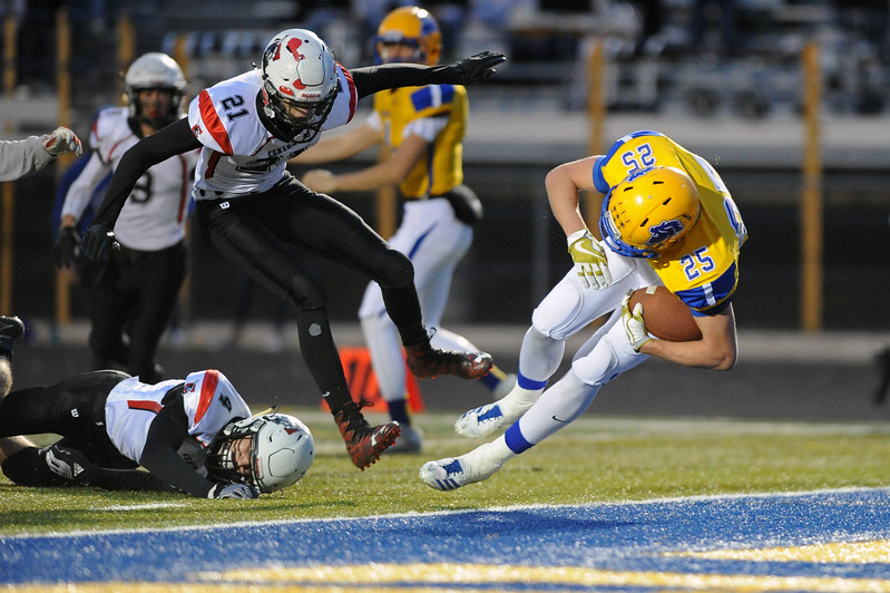 Parker Christensen (25) falls through the Cheyenne Central defense into the end zone on Friday, Oct. 27 at Homer Scott Field. Christensen scored five touchdowns in Sheridan's 54-7 win. Mike Pruden | The Sheridan Press