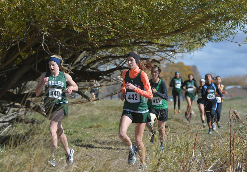 Justin Sheely | The Sheridan Press<br /> Tongue River's Kalie Bocek, left, and Macey McArthur run during the 2A east conference cross-country meet Saturday at Tongue River High School in Dayton.