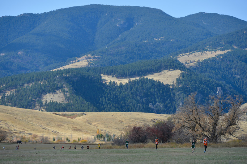 Justin Sheely | The Sheridan Press<br /> Middle school cross-country boys run with a view of the Bighorn Mountains Saturday at Tongue River High School in Dayton.