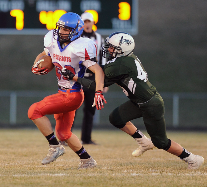 Running back Dawson Butts, left, tries to escape the grasp of Cade Reish on Friday, Oct. 13 at Tongue River High School. Mike Pruden | The Sheridan Press