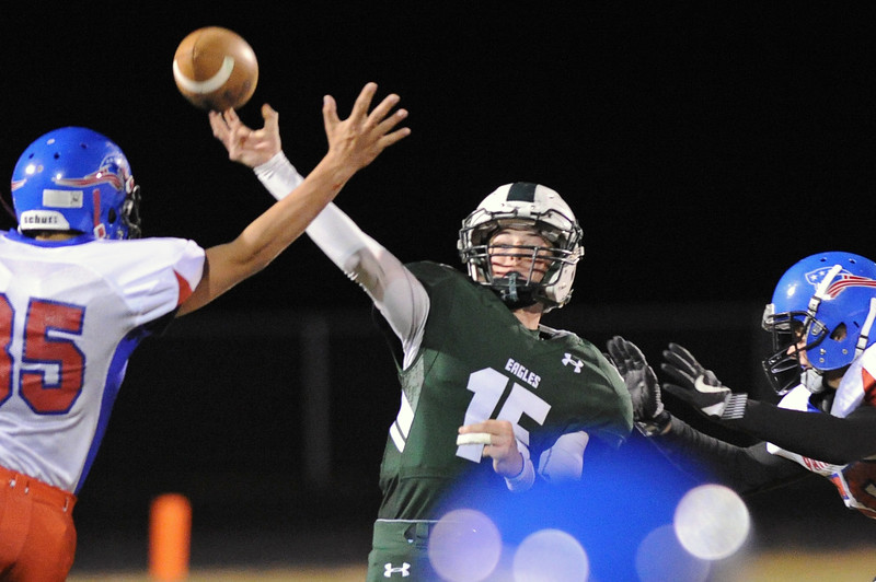 Quarterback Luke Stutzman launches a pass under pressure on Friday, Oct. 13 at Tongue River High School. Stutzman connected with J.T. Hammond for a 60-yard score. Mike Pruden | The Sheridan Press
