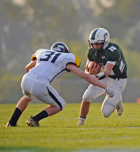 Quarterback Luke Stutzman rushes toward a Wright defender on Friday, Sept. 1 at Tongue River High School. Mike Pruden | The Sheridan Press