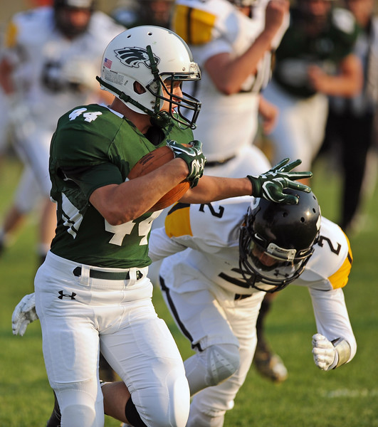 Zach Schankey stiff arms Wright's Dax Yeradi in the first half of Tongue RIver's 14-6 victory on Friday, Sept. 1 at Tongue River High School. Mike Pruden | The Sheridan Press