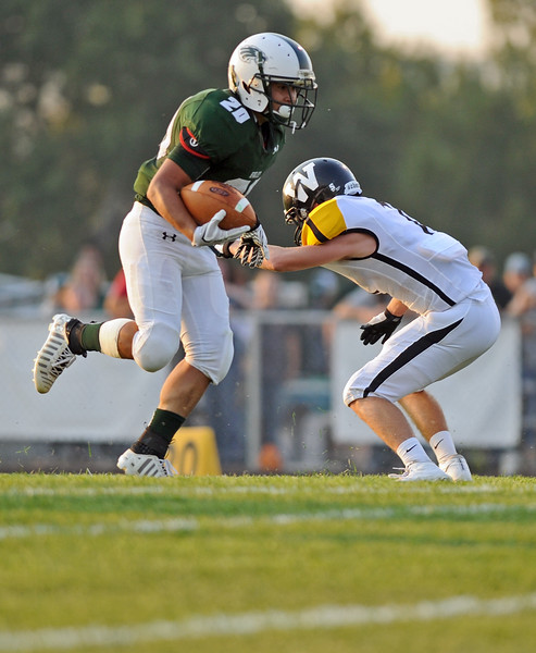 Elias Dillon-Bennett jukes a Wright defender on his way to a 16-yard touchdown run on Friday, Sept. 1 at Tongue River High School. The score was Tongue RIver's first touchdown of the season. Mike Pruden   The Sheridan Press