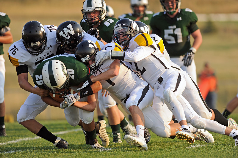 Elias Dillon-Bennett carries Wright defenders to the ground on a rush on Friday, Sept. 1 at Tongue River High School. Mike Pruden   The Sheridan Press