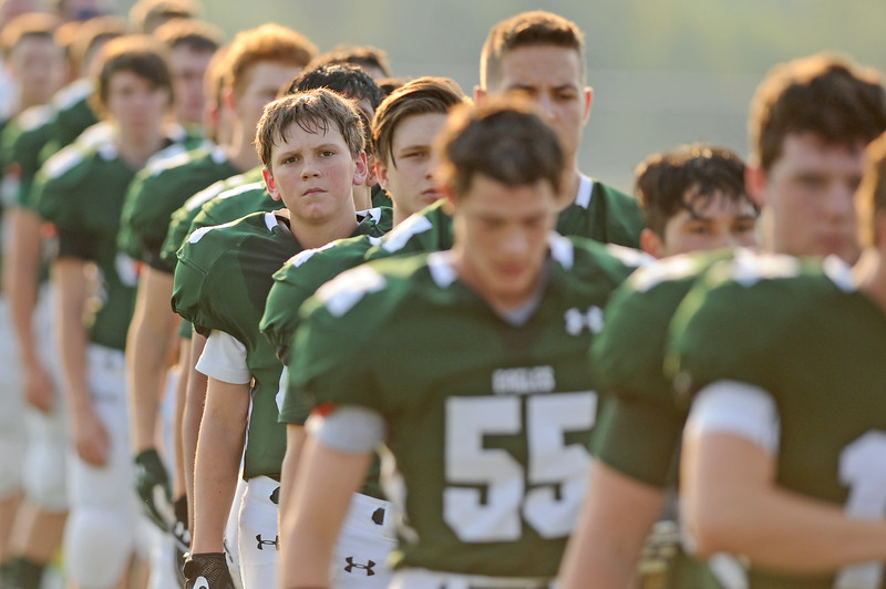 The Tongue RIver football team lines up for the national anthem before the start of its game against Wright on Friday, Sept. 1 at Tongue River High School. Mike Pruden | The Sheridan Press