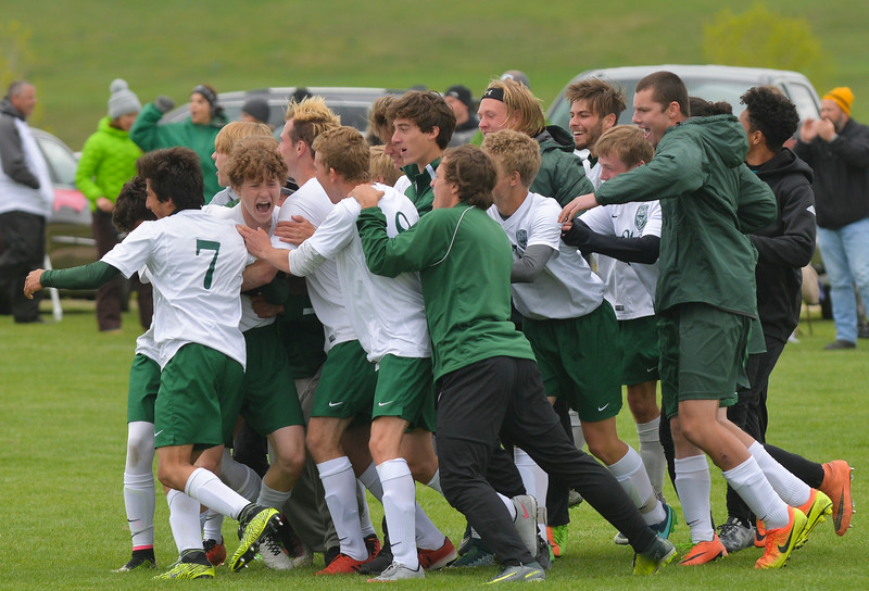 Justin Sheely | The Sheridan Press<br /> The Trojans celebrate after winning the shootout during the first round of the boys class 4A State Soccer Championship Thursday at the Big Horn Equestrian Center. The Trojans won in a shootout to advance to face Cheyenne Central in the semifinals on Friday.