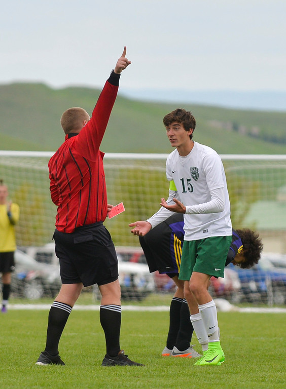 Justin Sheely | The Sheridan Press<br /> Kelly Walsh's Austin Kampa is ejected from the game during the first round of the boys class 4A State Soccer Championship Thursday at the Big Horn Equestrian Center. The Trojans won in a shootout to advance to face Cheyenne Central in the semifinals on Friday.