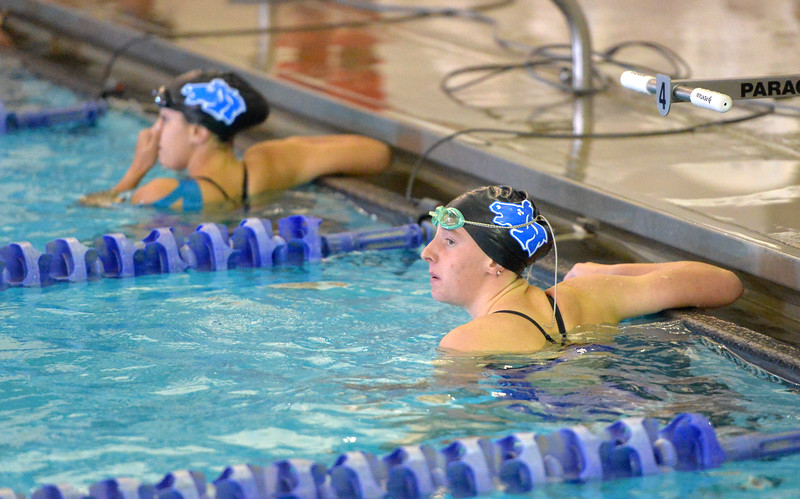 Justin Sheely | The Sheridan Press<br /> Sheridan High School's Pippin Robison, right, and Teal Scheuber look at the score board after finishing the 50m freestyle during the swim meet Tuesday at the Sheridan Junior High School Pool.