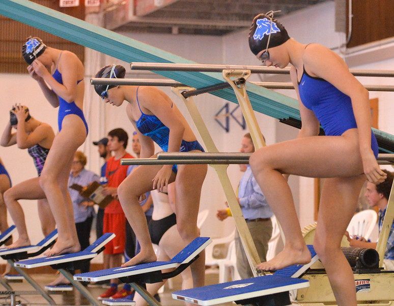 Justin Sheely | The Sheridan Press<br /> Sheridan High School's Zoe Robison, left, and Pipper Carroll, right, step onto the blocks during the swim meet Tuesday at the Sheridan Junior High School Pool.