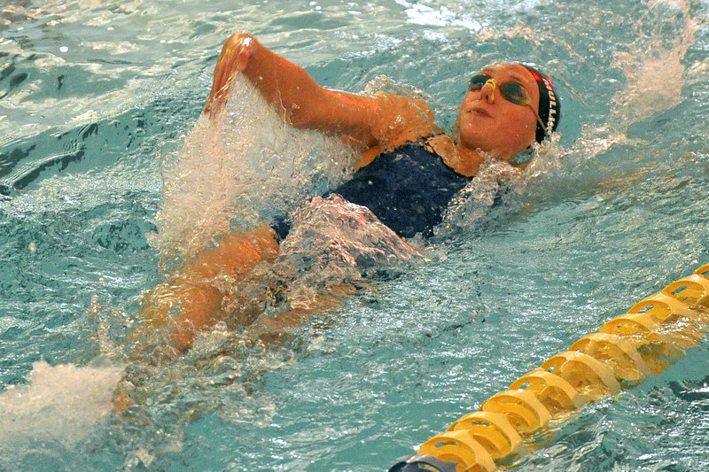 Jadyn Mullikin swims the 100-meter backstroke during the Sheridan Invite on Saturday, Sept. 23 at Sheridan Junior High School. Mike Pruden | The Sheridan Press