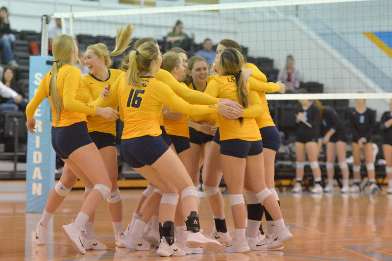 Justin Sheely | The Sheridan Press<br /> The Lady Golden celebrate their sweep over Sheridan College during the Region IX championship game Saturday in the Bruce Hoffman Golden Dome. Laramie County Community College won three straight sets to become the Region IX champions.