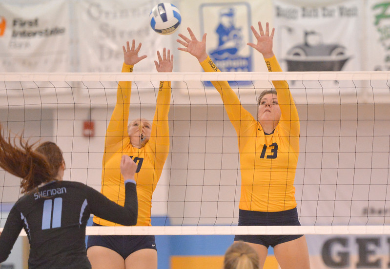 Justin Sheely | The Sheridan Press<br /> Lady Golden Eagles' Kyra Brandt, left, and Payton Stack try to block a Sheridan ball during the Region IX championship game Saturday in the Bruce Hoffman Golden Dome. Laramie County Community College won three straight sets to become the Region IX champions.