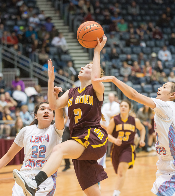 Mike Dunn | The Sheridan Press<br /> Emily Blaney, center, goes for a lay up during the 2A girls state title game Saturday at the Casper Events Center. The Lady Rams won their first state title since 2009.