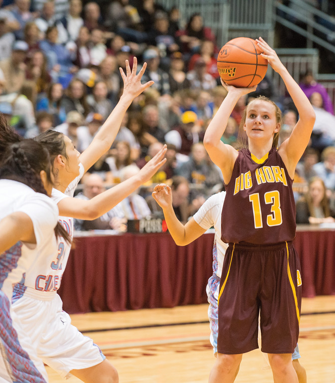 Mike Dunn | The Sheridan Press<br /> Sydney Schmidt, 13, takes a shot during the 2A girls state title game Saturday at the Casper Events Center. The Lady Rams won their first state title since 2009.