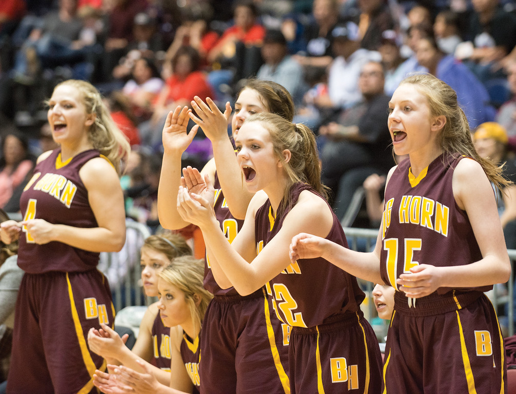 Mike Dunn | The Sheridan Press<br /> The Big Horn Lady Rams' bench celebrates a shot near the end of the game during the 2A girls state title game Saturday at the Casper Events Center. The Lady Rams won their first state title since 2009.