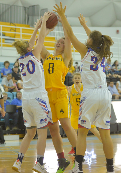 Justin Sheely | The Sheridan Press<br /> Wyoming's Lyndzi Rich of Worland tries a shot against Montana defenders during the girls Wyoming vs Montana All-Star Game Friday in the Bruce Hoffman Golden Dome at Sheridan College. Montana girls won 69-68.