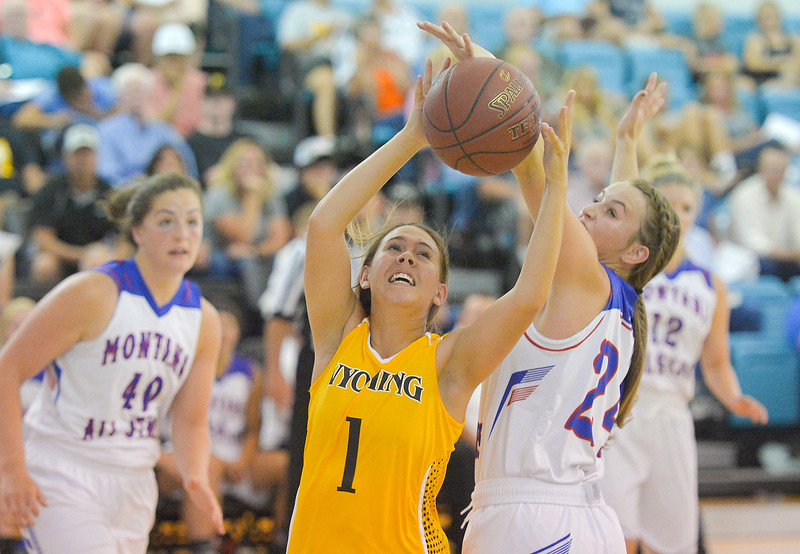 Justin Sheely | The Sheridan Press<br /> Wyoming's Ashley Tehau of Buffalo shoots against Montana defenders during the girls Wyoming vs Montana All-Star Game Friday in the Bruce Hoffman Golden Dome at Sheridan College. Montana girls won 69-68.