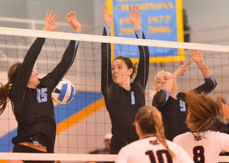 Justin Sheely | The Sheridan Press<br /> Lady Generals, from left, Ashlee Purcella, Miranda Gallagher and Maranda Koch try to block a ball from Western Wyoming during the first round of the Region IX Tournament Wednesday in the Bruce Hoffman Golden Dome at Sheridan College. Sheridan won the four set match against the Lady Mustangs.